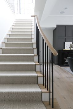 White and black herringbone staircase runner accents blond wood treads complemen. White and black herringbone staircase runner accents blond wood treads complemented with a blond wood handrail and iron spindles. White Staircase, Carpet Staircase, House Staircase, Staircase Remodel, Staircase Makeover, Modern Staircase, Staircase Design, Stairs With Carpet, Wood Handrail