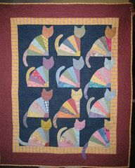Cat quilt - http://quiltingimage.com/cat-quilt/