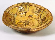 Slip-decorated earthenware dish with sgraffito design of bird and worm, made at Brookhill Pottery, Buckley, c.1640-1670