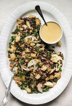 Roasted cauliflower salad with fragrant black rice, warm kale, crunchy seeds and a miso pear dressing. Vegan + Gluten free.