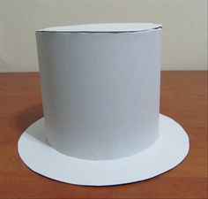 Your top hat is ready !  Now is the fun part. You can glue material or paper to the hat, add a band, feathers, flowers or any sort of decoration.  Enjoy!