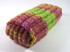 Alika Phone Sock by Lisa Reeve.   Combine colourful scraps of leftover sock yarn to make this stretchy ribbed cosy.