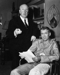 "Alfred Hitchcock and James Stewart on the set of ""REAR WINDOW"" (1954)."