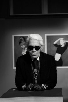 Lagerfeld Style  Chanelcreative directorKarl Lagerfeldfor the July issue ofVogue Japan. Lagerfeld with his signature glasses and fingerless gloves. The German designer poses alongside images featured inThe Little Black Jacket, an exhibit starring 113 celebrities and models in the iconic Chanel staple photographed by Lagerfeld with styling by Carine Roitfeld.