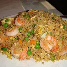 BETTER-THAN-TAKEOUT-FRIED-RICE Recipe Main Dishes with rice, boneless skinless chicken breasts, peas, white onion, garlic, eggs, sesame oil, soy sauce