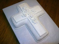 For a brother and sister making their First Communion. Wilton 2-Mix cross pan, decorated in buttercream.