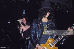 Axl Rose and Slash of Guns N' Roses perform an acoustic set at The Limelight on January 31, 1988 in New York City.