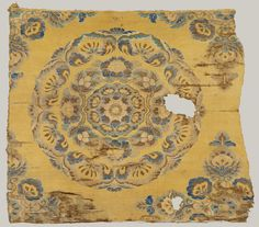 Textile with Floral Medallion  Period: Tang dynasty (618–907) Date: late 8th–early 9th century Culture: China Medium: Weft-faced compound twill Dimensions: Overall: 24 x 28 in. (61 x 71.1 cm) Mount (with plexi cover): 28 3/4 x 32 1/2 in. (73 x 82.6 cm)
