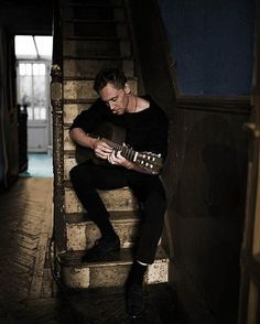 Tom Hiddleston Playing Guitar For A Photo Shoot At Home.