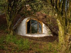 Man Builds 'Hobbit House' In Just 4 Months | SF Globe The home has a compost toilet and solar panels. It is heated with a wood burner. The walls, floors, and roof all contain straw barrels for increased insulation. The walls also contain lime plaster, a much better alternative to cement.
