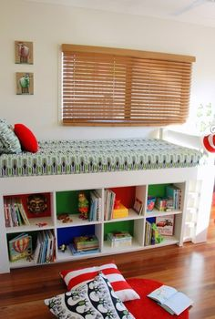 E-Decorating Before and After Photos by Ethos Design. A young boy's bedroom with a Dr Suess influence. White loft bed with cubby underneath . Boy Room, Kids Room, White Loft Bed, Bookshelves Built In, Built Ins, Bookcase, Under Bed Storage, Kid Beds, Bunk Beds