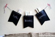 chalkboard garland to hold cutlery at a party