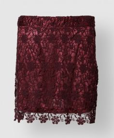 This maroon lace skirt is perfect for a night out on the town. The top layer is a flower lace, and the underlining is 100% polyester. It also features a maroon zipper on the side. Note, this skirt runs small.