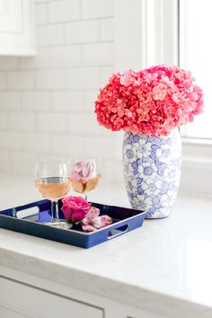 The Wedding Registry Items You Need To Be The Best Host Ever With Macy's - Belle The Magazine - Coffee Creative Photography | What must haves wedding gifts for your home you need on your bridal registry and store ideas | Tall blue vase  with pink flowers, wine cups and tray #ad #weddingregistry #bridalregistry #weddinggifts