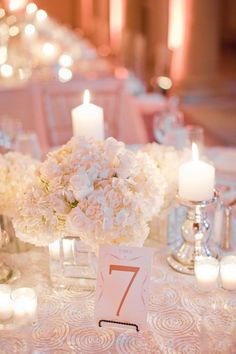 photo: Michelle March Photography via Style Me Pretty; classic all white wedding centerpiece; click to see more gorgeous white color wedding ideas;