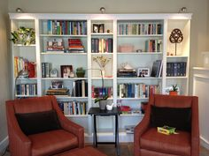 IKEA Billy Bookcases - love the lights & moulding! Need to create my library wall!!