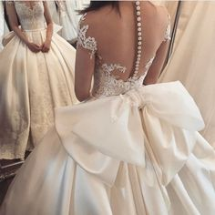 the bow of this lace appliques satin ball gown wedding dress is amazing