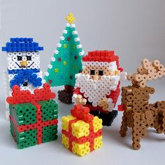 Christmas Perler Beads. Looks time and bead consuming, but pretty cool in the end!