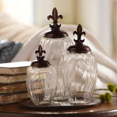 This elegant jar set with matching charger tray and Fleur-de-Lis finial lids can easily dress up a coffee table or console. #kirklands #puttogooduse
