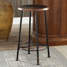 Sleek and stylish, this Whitman industrial counter stool is sure to enhance your decor. Industrial Counter Stools, Kitchen Stools, Bar Stools, Watercolor Architecture, Design 24, Cleaning Wipes, Chair, Brown, Table