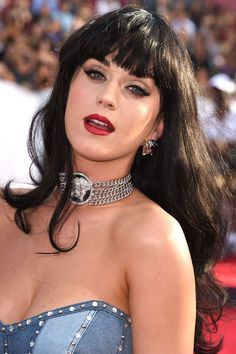 You HAVE To See Katy Perry's Beauty Evolution #refinery29  http://www.refinery29.com/2016/10/127194/katy-perry-best-hair-makeup-looks-photos#slide-23  In one of the most memorable moves in 2014 MTV Video Music Awards history, the singer showed up wearing a remarkably similar outfit to Britney Spears circa 2001, only this time the look was paired with wispy, straight-across bangs and a brick-red lipstick....