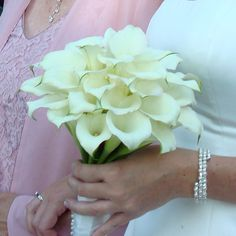 Calla lilies for elegance   Designed by Flowers By Antonella