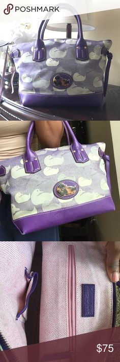 Authentic Dooney & Bourke Purse Beautiful purple and duck print Dooney. Used. Outside is in good condition. Inside condition has a few stains and pen marks. Zip to close, one inside zip compartment and one cell phone slot. Overall a great purse. Dooney & Bourke Bags Shoulder Bags