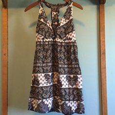 Racerback patterned dress Black and white light cotton sundress. Has a t-strap ruffle back. Short and flirty Dresses Midi