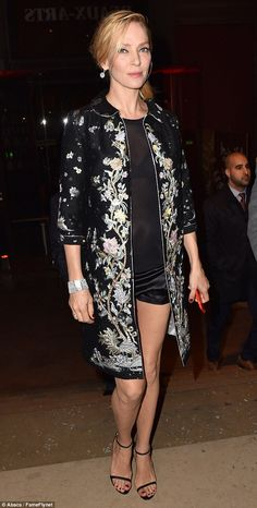 Intricate: Sitting just above the knee, Uma layered a simple black mini dress beneath a jacket that was emblazoned with an ornate floral pattern