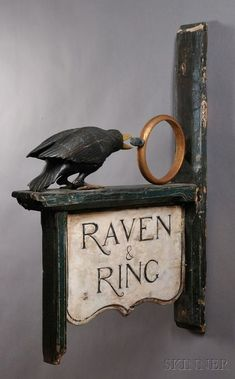 Raven and The Ring Signage