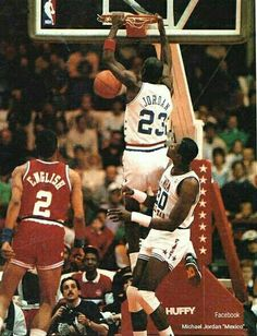 The GOAT slams in two points during an all star game as Alex English and teammate Patrick Ewing watch.