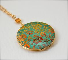 Vintage Locket Necklace with Turquoise and Gold Floral Wallpaper Print. $40.00, via Etsy.
