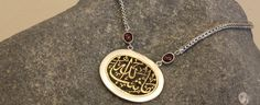 Arabic calligraphy necklace.