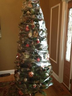 the best way to put up your artificial christmas tree if youve - Best Way To Store Christmas Lights