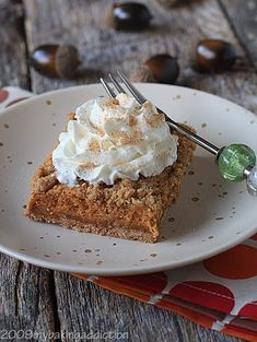 Pumpkin Streusel Cheesecake Bars | My Baking Addiction. Ingredients: pouch oatmeal cookie mix, cinnamon graham cracker crumbs, cinnamon, pecans, butter. Cheesecake: cream cheese, sugar, pumpkin, flour, pumpkin pie spice, ginger, whipping cream, eggs