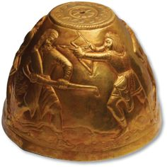 An act of warfare is portrayed on the other side of the bowl-shaped vessel. A Scythian warrior fires an arrow at a foe, while another lies dead and beheaded at his feet.