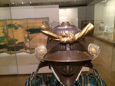 This helmet and mask was produced by one of the best armour makers of the Edo period, the Saotome school. The Daki Kashiwan mon (double oak-leaf family crest) of the Hachisuka clan appears on the Kabuto.    This is on display at the National Gallery of Victoria (NGV), Melbourne, Australia till Nov 2014 Best Armor, Samurai Armor, Edo Period, Family Crest, Melbourne Australia, Helmets, Victoria, Good Things, Display