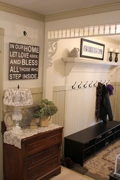 Entry bench, hooks, and shelf, integrated into the wainscoting.