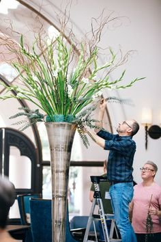 Paul Thomas arranges the large floral pieces in the lobby of the hotel with Shane Meehan assisting. Hotel Flower Arrangements, Hotel Flowers, Safari Wedding, Wholesale Florist, Spring Wedding Flowers, Floral Supplies, Hotel Lobby, Fall Decorating, Wedding Designs