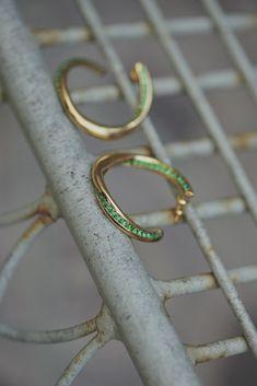 Forward facing, modern twisted hoop with emerald green stones. Fashion Earrings, Fashion Jewellery, Emerald Green Stone, Sterling Silver Jewelry, Silver Rings, Cleaning Silver Jewelry, Twisted Metal, Metal Fashion, Treasure Island