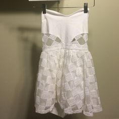 Nasty gal white romper size small Nasty gal white romper size small. The squares are crotchet material and very durable. The top is stretchy material as well as the shorts for the romper. Never worn because it does not fit me and cannot model it. New without tags. Please message me if you need more pictures. Nasty Gal Dresses Mini
