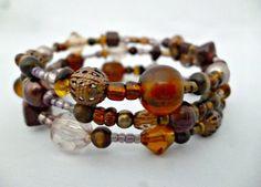 Poppito - Product: Brown bead wrap Bracelet £8.00 reccabella