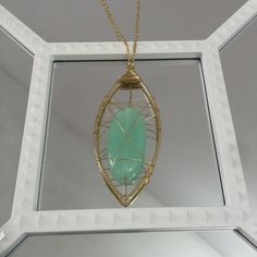 """Mint & Gold Necklace Gold tone chain necklace with wire caged mint stone. Approximately 26""""+ adjustable chain. 3"""" pendant. Price is firm. Discounts on bundles. Jewelry Necklaces"""
