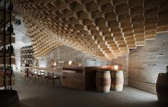 located on chenshan mountain, china, shanghai godolphin has turned an old military bunker into the new home of the international wine + spirit museum.