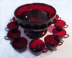 Here is a era 14 piece punch set that was made by Anchor Hocking. The color is royal ruby and it consists of the 10 inch bowl, the base and 12 punch cups. This set was found in its origina Vintage Dishes, Vintage Glassware, Vintage Kitchen, Vidro Carnival, Red Punch, Punch Bowl Set, Fenton Glass, Glass Kitchen, Anchor Hocking