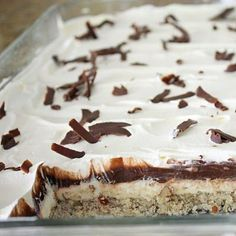 Four Layer Yummy  pecan shortbread crust covered with cream cheese filling topped with pudding and finished with layer of whipped cream and shavings