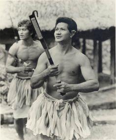 Two Samoan men with fireknives