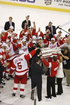 Red Wings owner Mike Ilitch raises the Stanley Cup to the delight of the team. Red Wings win the game 3-2 and the Stanley Cup, June 4, 2008. ( The Detroit News / John T. Greilick )
