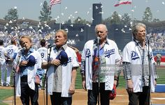 The Beach Boys (L-R) Al Jardine, Bruce Johnston, Mike Love and Brian Wilson sing the national anthem during Los Angeles Dodgers opening day at Dodger Stadium on April 10, 2012 in Los Angeles, California.