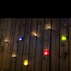 Mason jar lights on fence for parties. Cute!